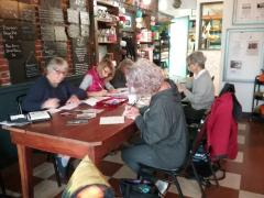 Mason County League members writing postcards to their legislators on issues of community concern.