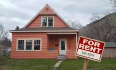 photo of house with for rent sign in the front