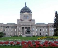 image of Montana state capitol building with flower beds in foreground