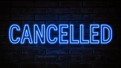 The word CANCELLED in blue neon lights on a black background