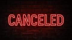 Word CANCELED in Red Neon letters on a brick wall