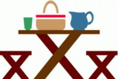 picnic table with food basket
