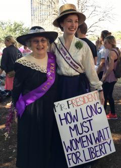 Suffragists dressed in vintage clothes at the Women's March