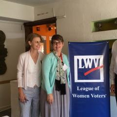 Members at annual meeting with LWV signage