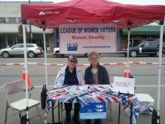 League Members Staff Voter Registration Table At Farmers Market