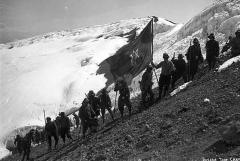 Women planting the sufragette flag on Mount Rainier