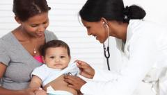 Mother and child with female doctor