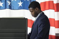 African-American man at voting booth