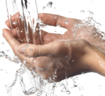 Drinking Water flowing over woman's hands from the faucet