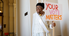 Woman Holding Sign Your Vote Matters