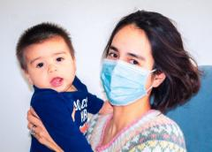 Mom in mask with baby during Coronavirus COVID-19 outbreak.