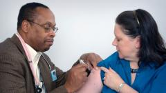 Doctor giving flu shot to patient