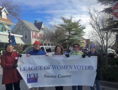 Photo of members of LWVSC with banner