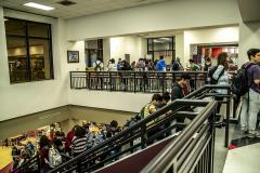 Texas State Students in line to vote on stairs