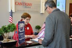 Barb Laimins registers voters at the Naturalization Ceremony.
