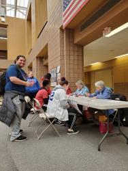League member registering voter