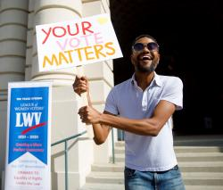 Man Holding Your Vote Matters Sign Credit LWVUS