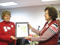 Arlene Gillette receiving award