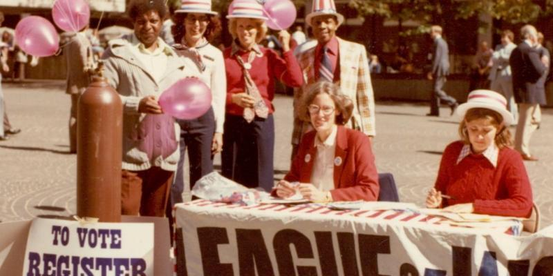 registering voters at registration table c. 1970s