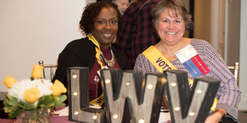 Cincinnati Area (OH) League members at table with LWV sign