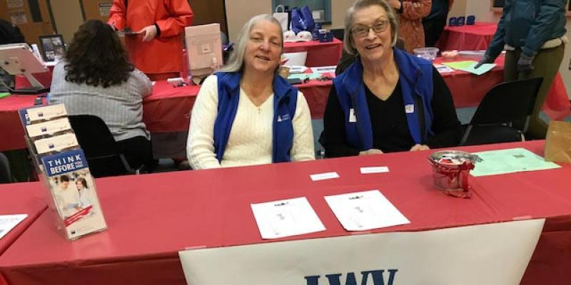 LWVCC register voters at local college fair