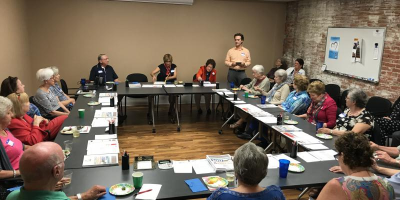 Members receive information from Board of Elections representatives