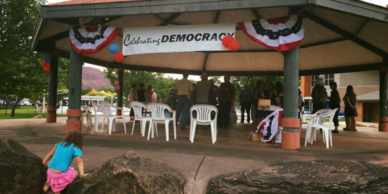 LWV members attend Meet the Candidates event under gazebo in park