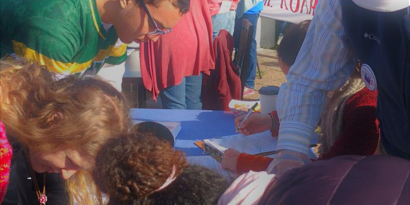 Registering new voters at the local women's march
