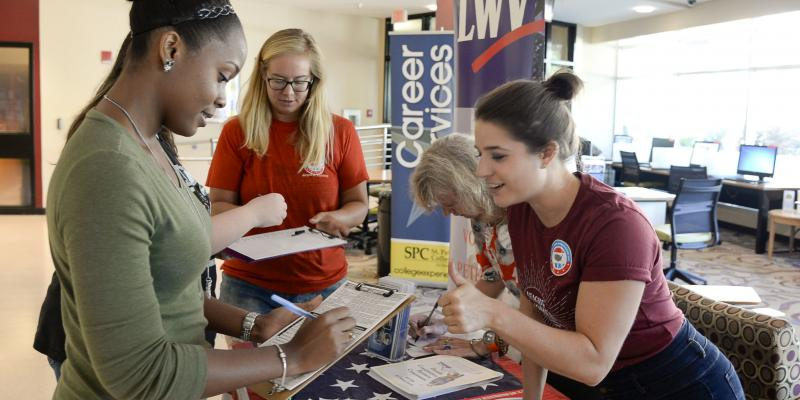 LWV members register new voters on college campus