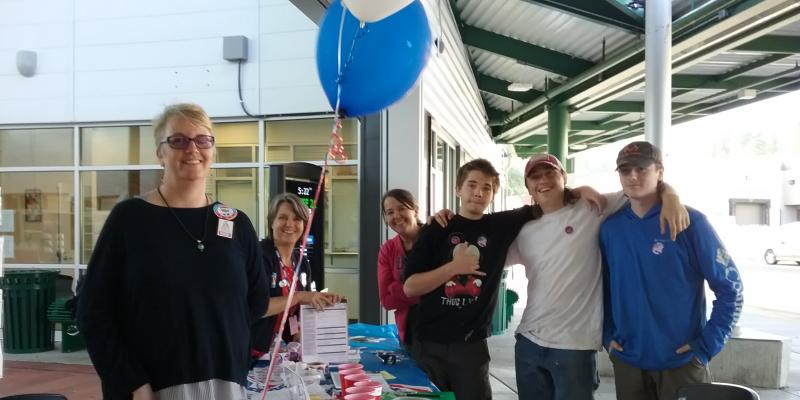 Registering voters at the Transit Center on National Voter Registration Day