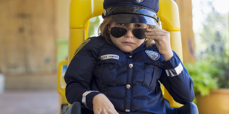 4-year old boy dressed as a police officer