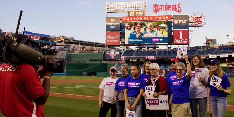Group photo of League members at Washington Nationals game where LWV was recognized on the scoreboard
