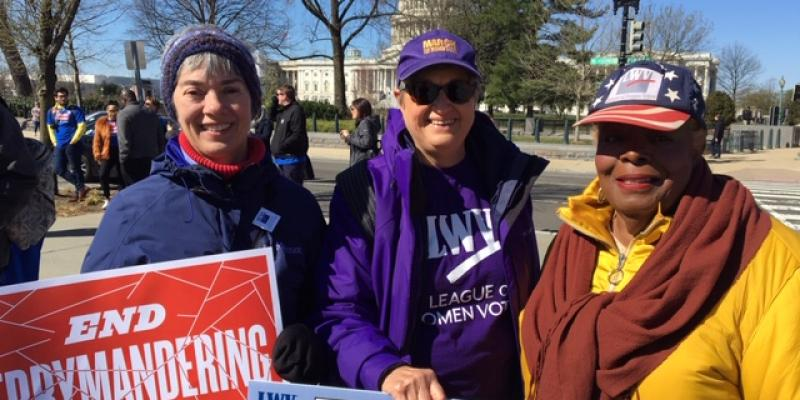 Picture of, L to R: Deb Wake (LWVFA,LWV-VA), Kathy McGuire (LWVMC,LWVNCA) and Linda Softli (LWVDC),  at rally for SCOTUS hearing.