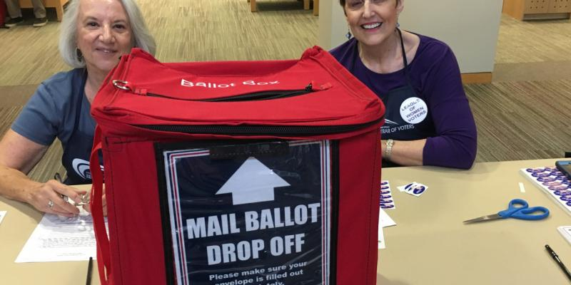Two League members manning the mail ballot drop off
