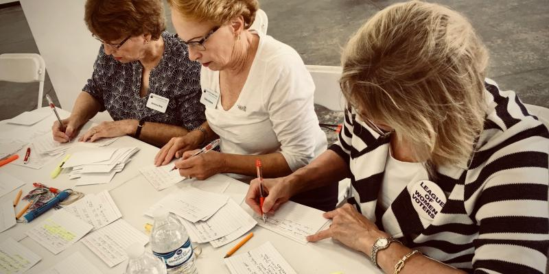 League members sorting questions at a candidate forum