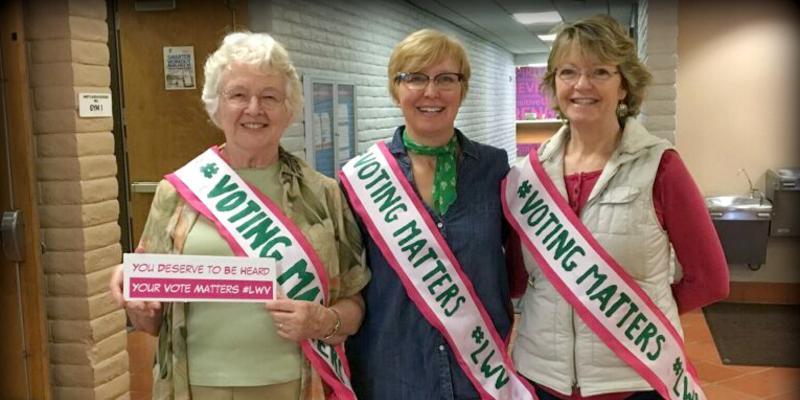Three members wearing Voting Matters sashes