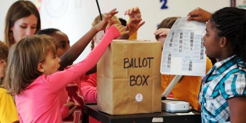 Elementary school kids casting their ballots