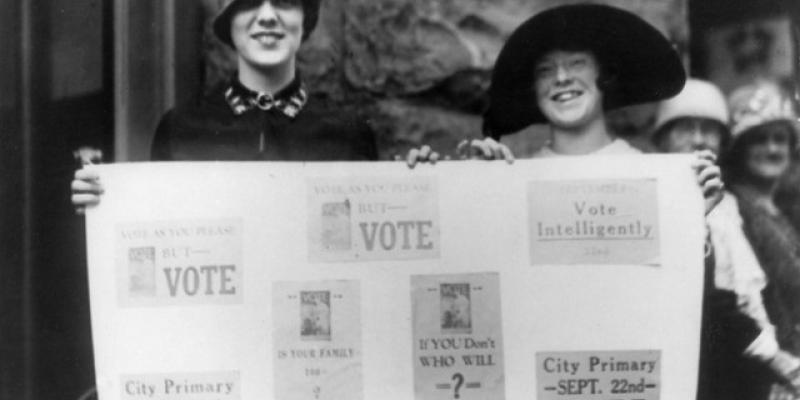 Suffragettes Holding Voting Banner