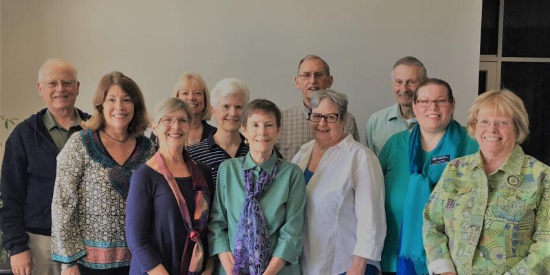 group picture of 2018-2019 board members against beige wall