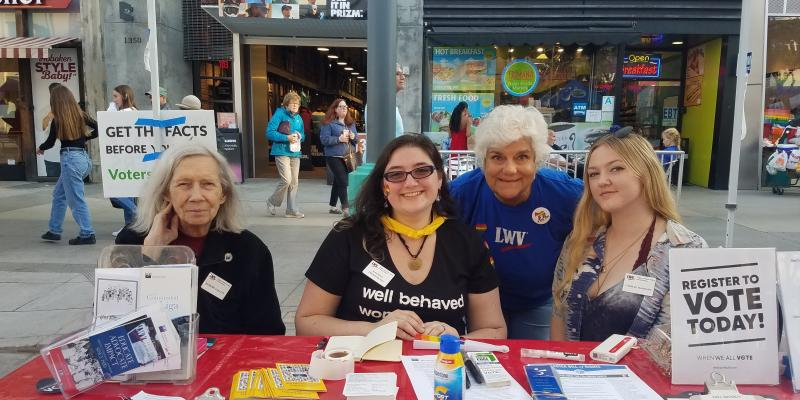 Members of the League of Women Voters of Santa Monica register voters on the Third Street Promenade