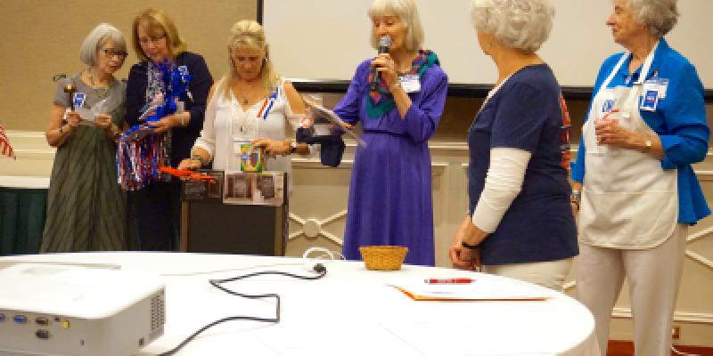 Three past presidents announcing Show off your League Display Winners, Sheila Haney, Barbara Zia, and Keller Barron