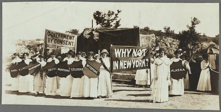 """NY Suffragist displaying the banner """"Why Not Now New York?"""""""