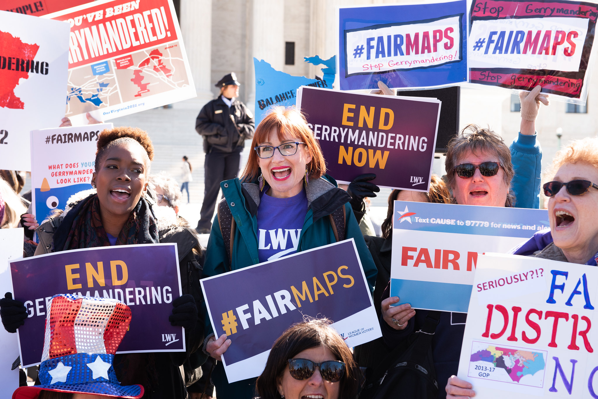 LWV Fair Maps Picture of Leaguers holding signs