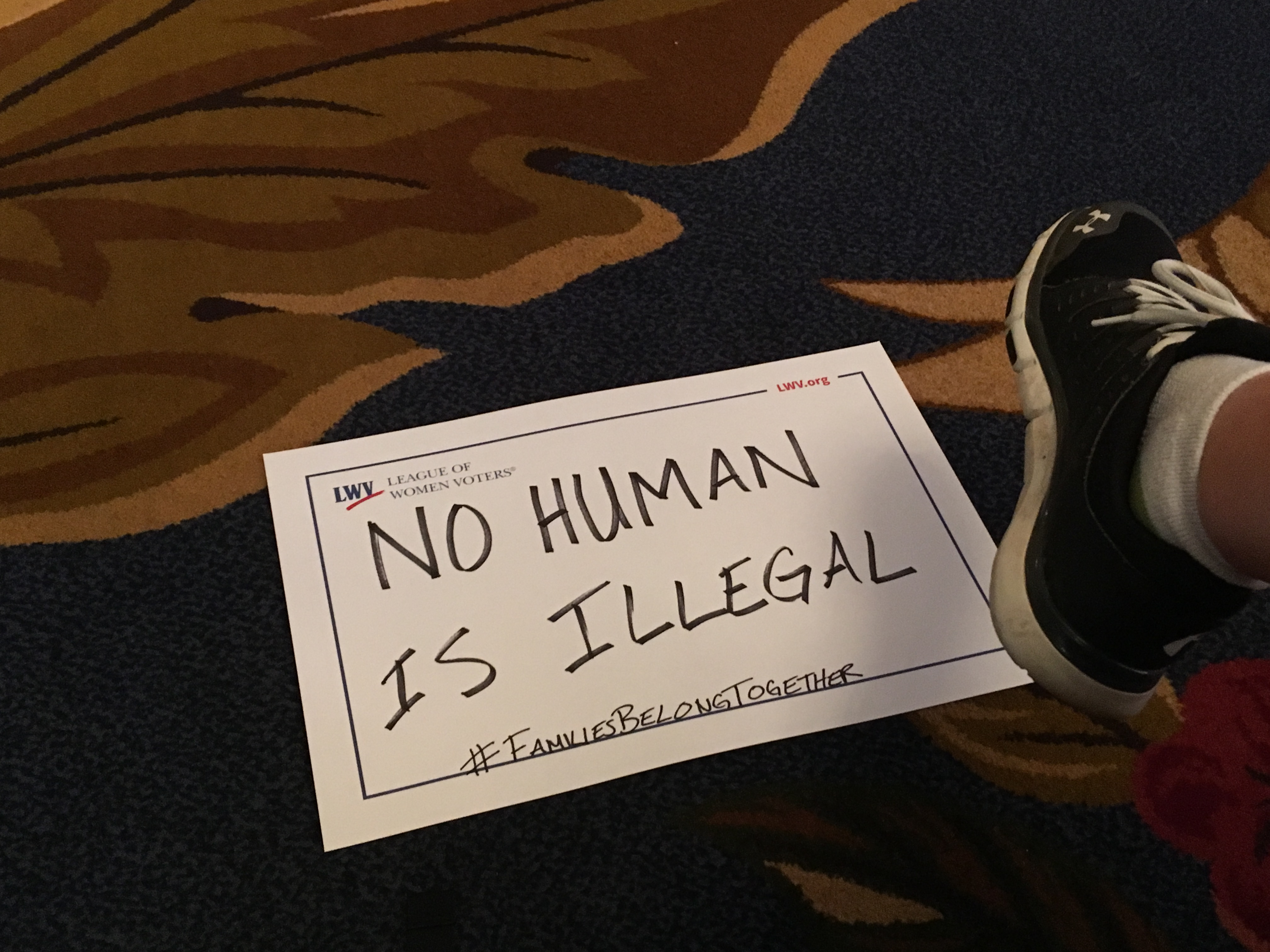 No Human Is Illegal sign