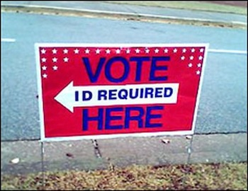 Vote here. ID required. Posted vote sign.